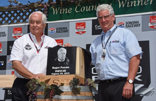 """Roger Penske shown being inducted into Sonoma Raceway's """"Wall of Fame"""" by track president and general manager Steve Page. [Joe Jennings Photo]"""