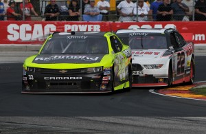 Paul Menard holds off Ryan Blaney on his way to winning the Road America 180 NASCAR Xfinity Series race. [John Wiedemann Photo]