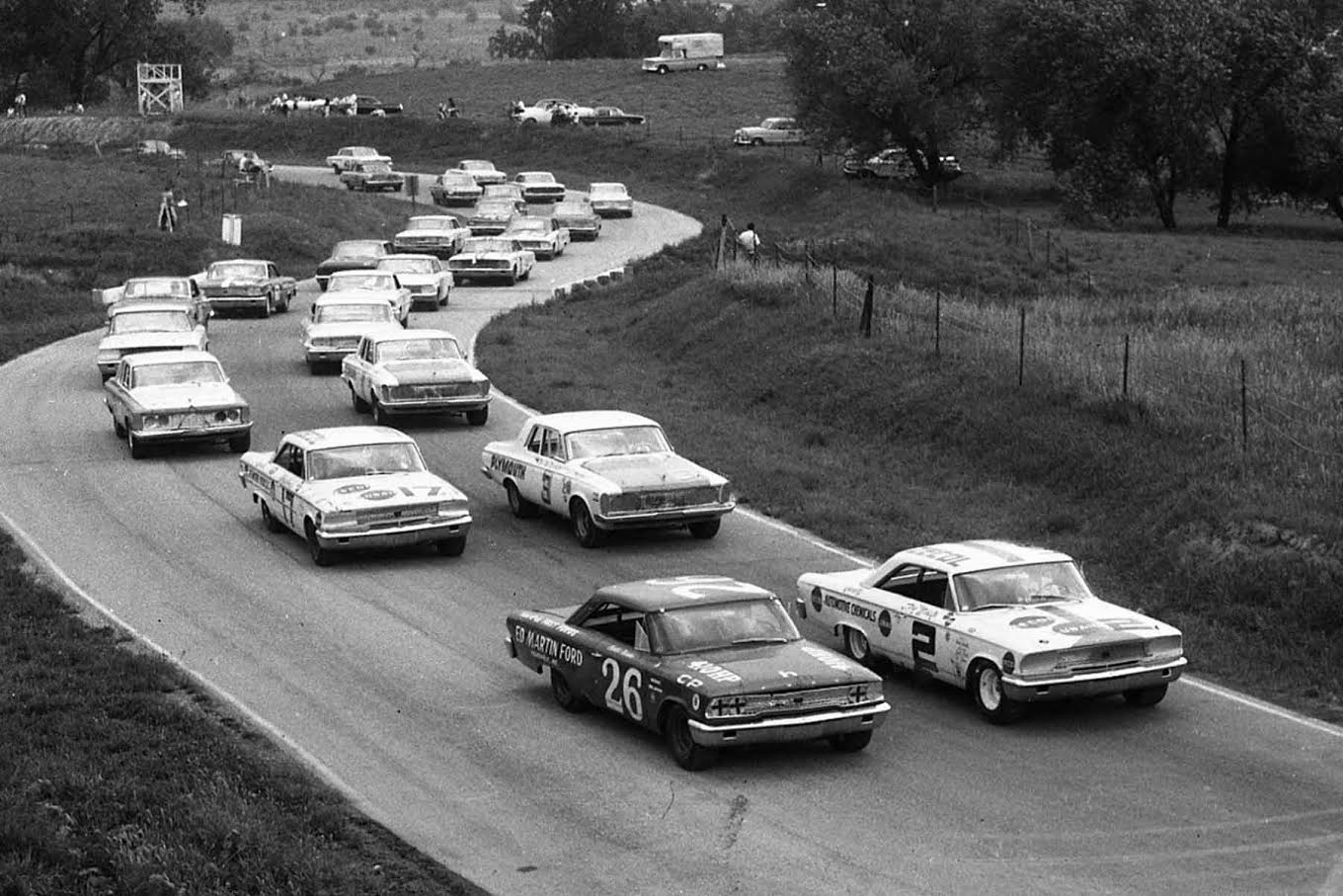 The field is lined up ready to go at Meadowdale for the scheduled 250-mile USAC Stock Car race. Row one has the 1963 Fords of Don White #2 and Curtis Turner #26. Row two is occupied by Norm Nelson #3 and Harry Heuer #17. [Photo by Russ Lake]