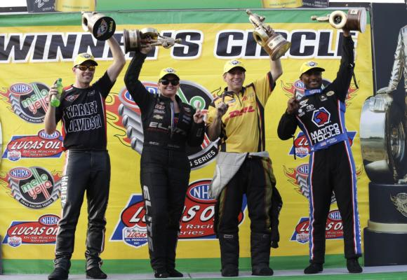 Andrew Hines (PSM), Erica Enders (PS), Del Worsham (FC) and Antron Brown (TF) celebrate wins at the NHRA Carolina Nationals at zMAX Dragway. (CMS/HHP)