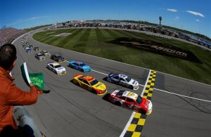Kevin Harvick leads the field at the start of the 2014 NASCAR Sprint Cup Series Hollywood Casino 400 at Kansas Speedway. [Credit: Chris Trotman/NASCAR via Getty Images]