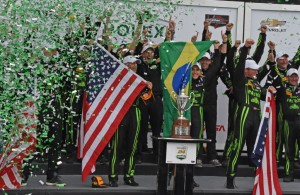 Rolex 24 winners wave their flags while being bathed in confetti. [Joe Jennings Photo]