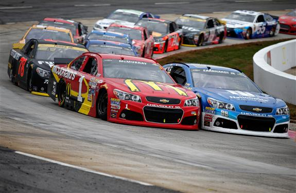 Jamie McMurray and Dale Earnhardt Jr lead the pack during the NASCAR Sprint Cup Series Goody's Headache Relief Shot 500 at Martinsville Speedway on November 1, 2015 in Martinsville, Virginia. [Credit: Todd Warshaw/NASCAR via Getty Images]