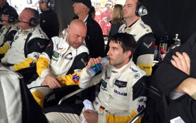 Jan Magnussen and Rocky confer in the Corvette pits.  [Eddie LePine photo]