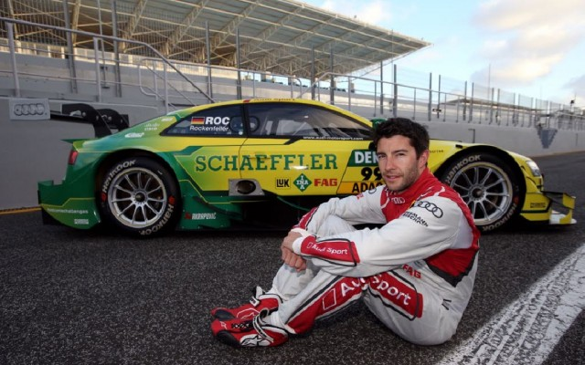 Mike Rockenfeller and his DTM championship car.  [Photo by Audi Motorsport]