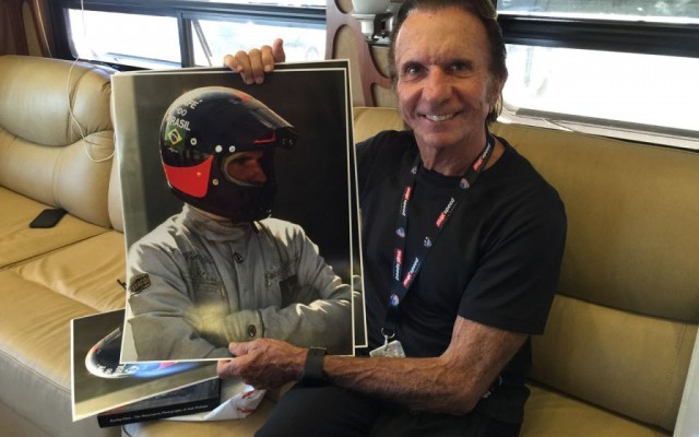 Emerson Fittipaldi with his portrait.  [Photo by Eddie Lepine]
