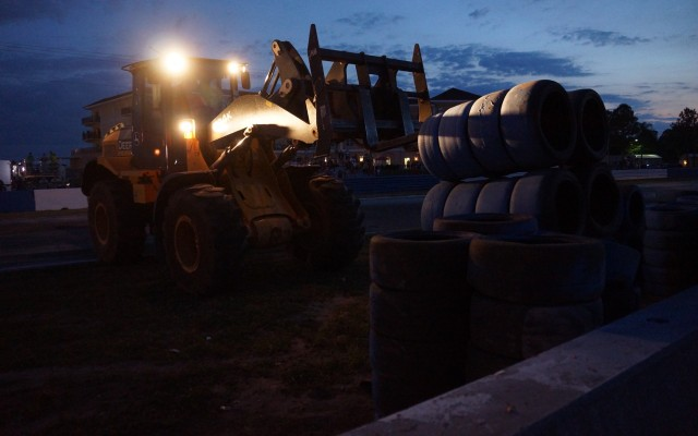 Barrier repairs during night practice at the hairpin.  [Photo by Jack Webster]