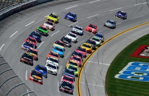 The field races in a tight pack during the NASCAR Sprint Cup Series GEICO 500 at Talladega Superspeedway. [Credit: Jared C. Tilton/Getty Images]