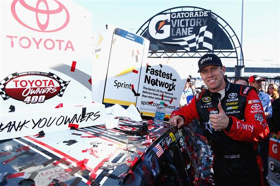 Carl Edwards poses with the winner's decal after winning the NASCAR Sprint Cup Series TOYOTA OWNERS 400 at Richmond International Raceway. [Photo by Daniel Shirey/NASCAR via Getty Images]