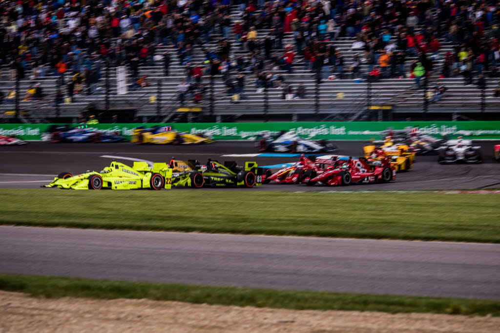 Simon Pagenaud leads the field during the IndyCar race at the Indianapolis Motor Speedway for the Angie's List Grand Prix. [Andy Clary Photo]