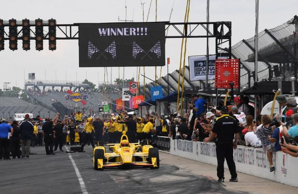 Helio Castroneves drives to victory after his crew gives him a blazing pit stop. [Russ Lake Photo]