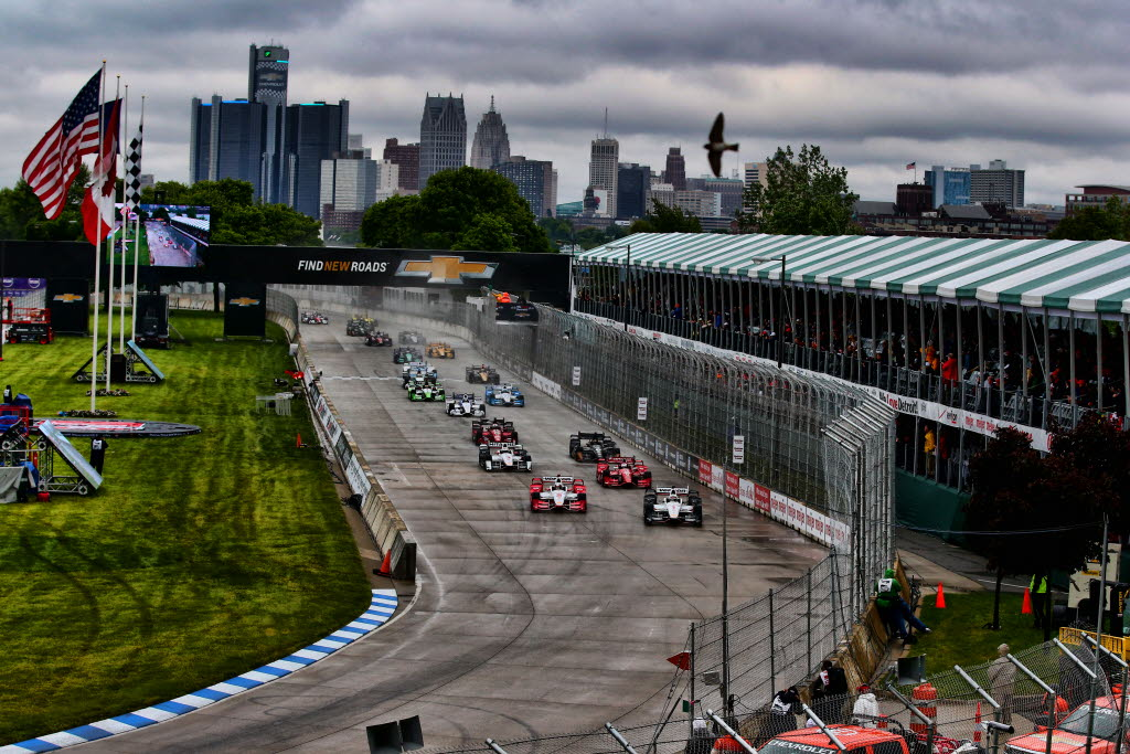 Juan Pablo Montoya and Will Power lead the field into Turn 1 to start Race 2 of the Chevrolet Dual in Detroit at Belle Isle Park -- Photo by: Bret Kelley