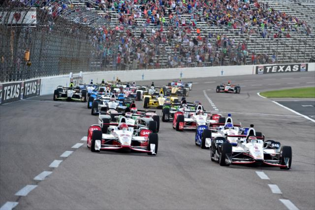 Will Power and Simon Pagenaud lead the field into Turn 1 during the early stages of the Firestone 600 at Texas Motor Speedway. [Photo by: Chris Owens]