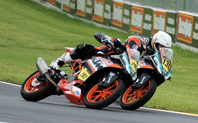 #297 Ezra Beaubier and #130 Renzo Ferreiro in Turn #5 during running of KTM RC Cup Race #2.  [Dave Jensen Photo]