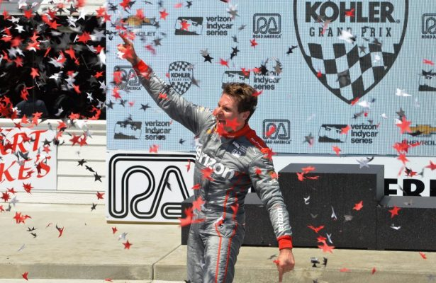 #12 Will Power cheering the crowd on after his victory in the Kohler Grand Prix at Road America. [Dave Jensen Photo]