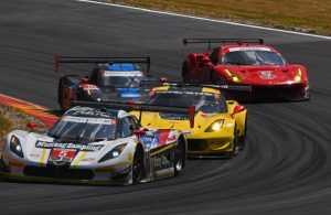 Winning action Express Racing Corvette negotiates Turn 7 in traffic. [Joe Jennings Photo]