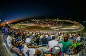 Fans watch all the excitement of the 2015 Iowa Corn 300 at Iowa Speedway. [Photo by: Shawn Gritzmacher]