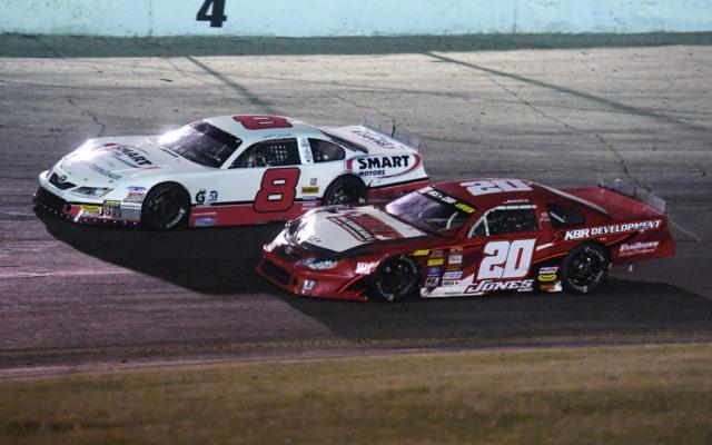 NASCAR teammates Matt Kenseth (8) and Erik Jones (20) battle for the lead in the Slinger Nationals.  [Russ Lake Photo]