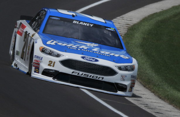 "Ryan Blaney drives the blue and white ""Trading One Uniform for Another"" #21 Wood Brothers Racing Ford. [John Wiedemann Photo]"