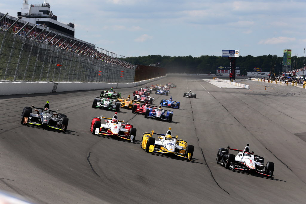 Will Power and Simon Pagenaud lead the field into Turn 1 at the start of the ABC Supply 500 at Pocono Raceway. [Photo by: Bret Kelley]