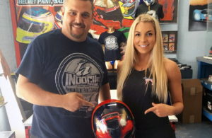 "Ryan Young and Lizzy Musi with the ""Eliminator"" helmet. [Photo courtesy Lizzy Musi and Indocil Art]"