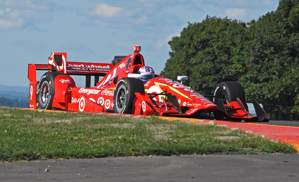 Scott Dixon shown zipping through the famed bus stop at Watkins Glen International. [Joe Jennings Photo]