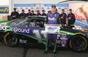 Denny Hamlin poses with the Coors Light Pole Award after qualifying for pole position for the Federated Auto Parts 400 at Richmond International Raceway. [Credit: Matt Sullivan/NASCAR via Getty Images]