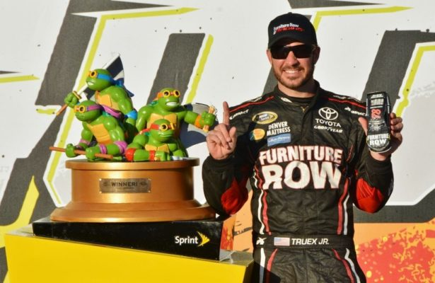 Martin Truex Jr. posing with his beautiful winners trophy in victory lane at Chicagoland Speedway. [Kim Kemperman Photo]