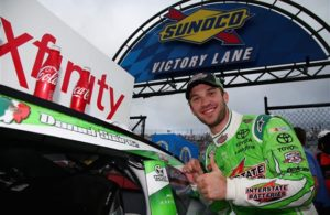 Daniel Suarez celebrates in Victory Lane after winning the NASCAR XFINITY Series Drive Sober 200 at Dover International Speedway. [Credit: Sarah Crabill/NASCAR via Getty Images]