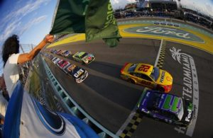 Denny Hamlin and Joey Logano lead the field past the green flag to start the 2015 Ford EcoBoost 400 at Homestead-Miami Speedway. [Credit: Jonathan Ferrey/NASCAR via Getty Images]