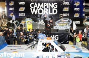 Johnny Sauter celebrates in Victory Lane after winning the 2016 NASCAR Camping World Truck Series Championship at Homestead-Miami Speedway. [Photo by Sean Gardner/NASCAR via Getty Images]