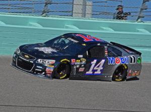 Tony Stewart powers through Turn 4 at the Homestead-Miami Speedway. [Joe Jennings Photo]