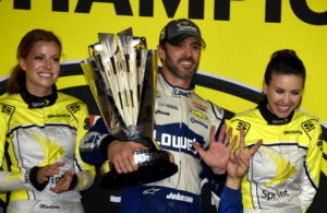 Winner Jimmie Johnson celebrates showing seven fingers, with help from his crew. [Joe Jennings Photo]