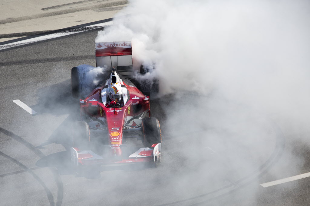 Sebastian Vettel making donuts at the Daytona International Speedway. [Photo by Thomas Murray]