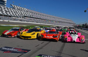 55 colorful Rolex24 entries lined-up on pit road. [Joe Jennings Photo]