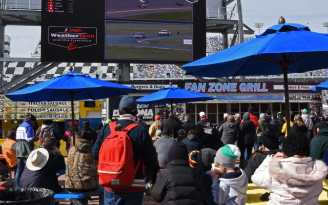 Fans congregate in FanZone to watch the finish on a large screen.  [Joe Jennings Photo]