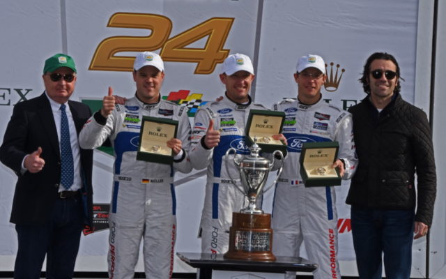GTLM winners Dirk Mueller, Joey Hand and Sebastien Bourdais receive Rolex hardware.  [Joe Jennings Photo]