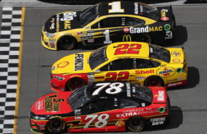 Martin Truex Jr., Joey Logano and Jamie McMurray race during the Monster Energy NASCAR Cup Series Advance Auto Parts Clash at Daytona International Speedway. [Credit: NASCAR Via Getty Images]