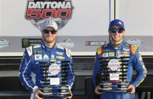 Pole winner Chase Elliott and Dale Earnhardt Jr. celebrate in Victory Lane after qualifying for the Monster Energy NASCAR Cup Series 59th Annual DAYTONA 500. [Credit: NASCAR Via Getty Images]