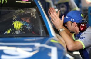 Jimmie Johnson talks with crew chief Chad Knaus during practice for the 59th Annual DAYTONA 500 at Daytona International Speedway. [Credit: NASCAR Via Getty Images]