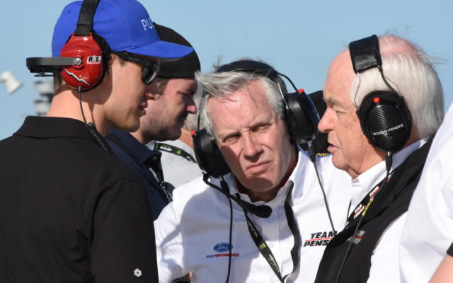 Joey Logano pays visit to Roger and Greg Penske in spotter's stand.  [Joe Jennings Photo]