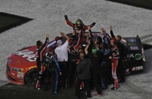 Winner Kurt busch celebrates with team at finish line. [Joe Jennings Photo]