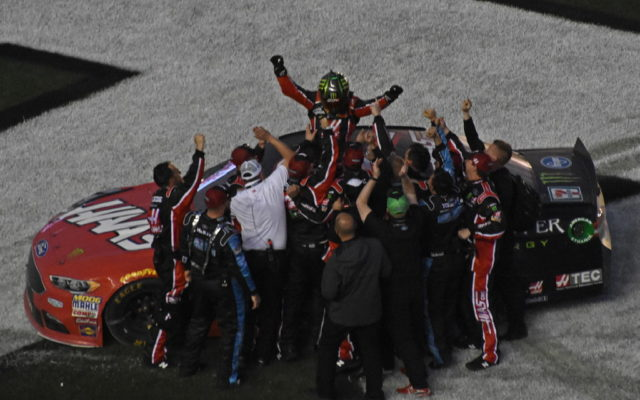 Winner Kurt busch celebrates with team at finish line.  [Joe Jennings Photo]