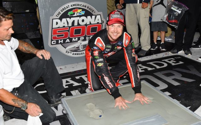 Kurt Busch getting his hands cemented in victory lane at the Daytona International Speedway.   [Kim Kemperman Photo]