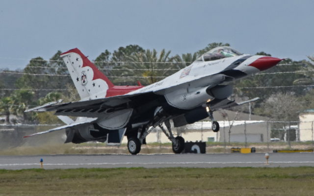 Maj. Ryan Bodenheimer does wheelie while landing in Daytona.  [Joe Jennings Photo]