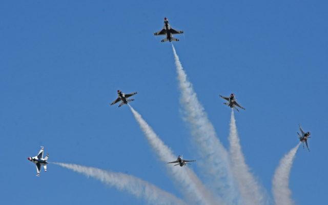 USAF Thunderbirds perform starburst display as part of their flyover at Daytona during National Anthem sung by vocalist Jordin Sparks.  [Joe Jennings Photo]