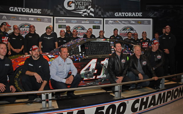 Winning crew pose next to No. 41 Ford Fusion.  [Joe Jennings Photo]
