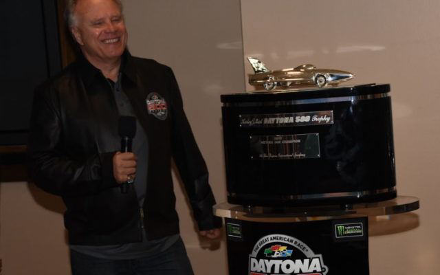 Team co-owner Gene Haas beams as he receives replica of winning trophy.  [Joe Jennings Photo]