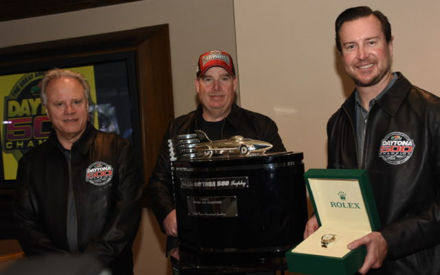 Gene Haas, Tony Gibson and Kurt Busch display new awards.  [Joe Jennings Photo]
