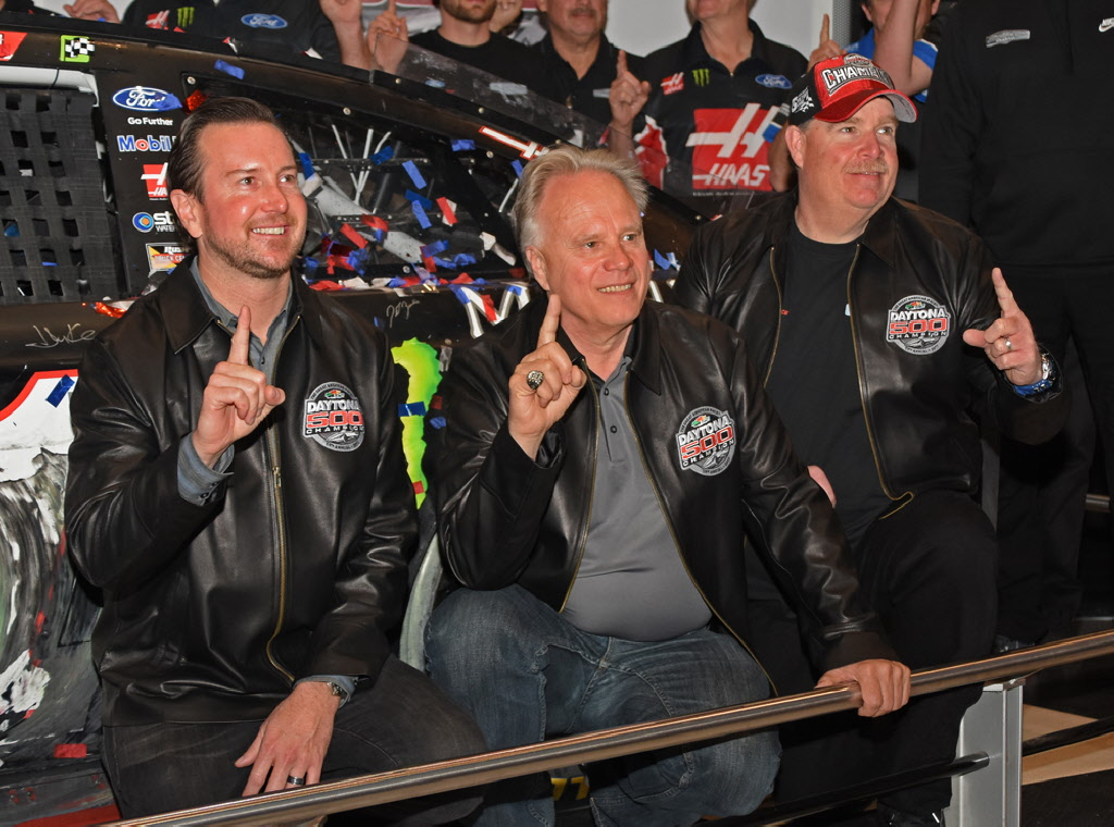 Kurt Busch, Gene Haas and Tony Glover hold up 1 finger symbolic of their Daytona 500 win. [Joe Jennings Photo]